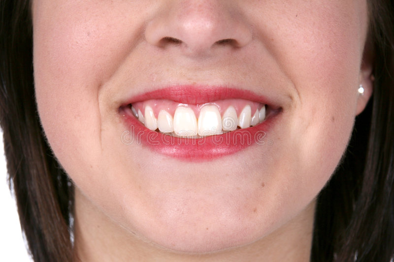 Close up of a pretty smile and great skin stock photography