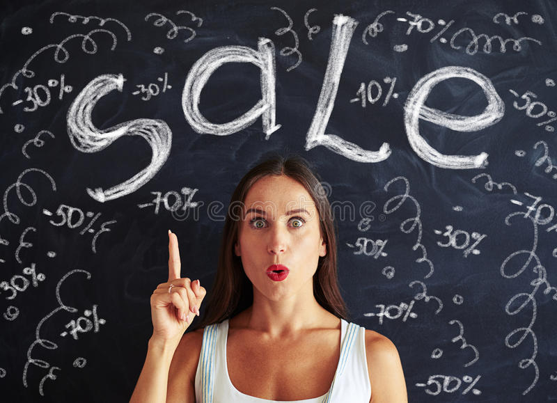 Close-up of pretty young lady making excited face about big sale stock photos