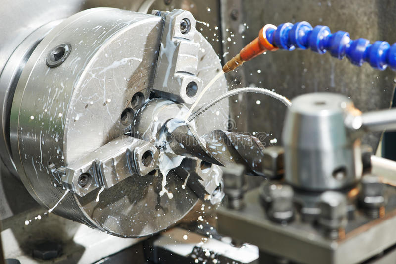 Close-up process of metal drill machining. Close up machining tool drill during metal cutting process boring a hole stock images