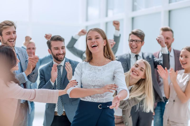 Professional business team congratulating their leader. photo with space for text royalty free stock photo