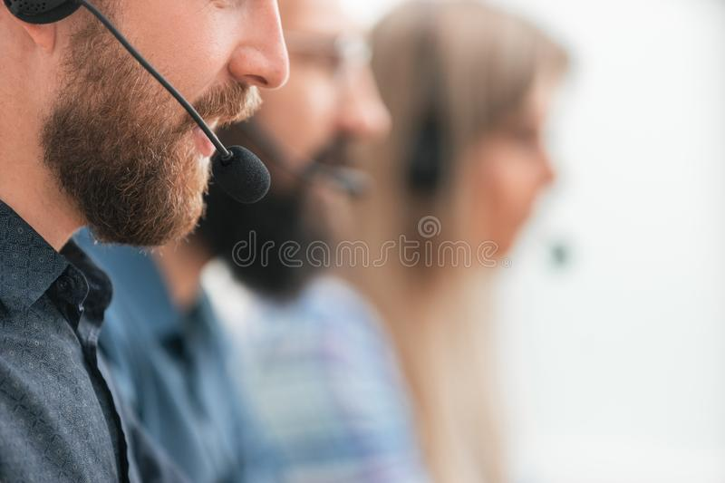 Close up. professional call center employee in the workplace. stock photos