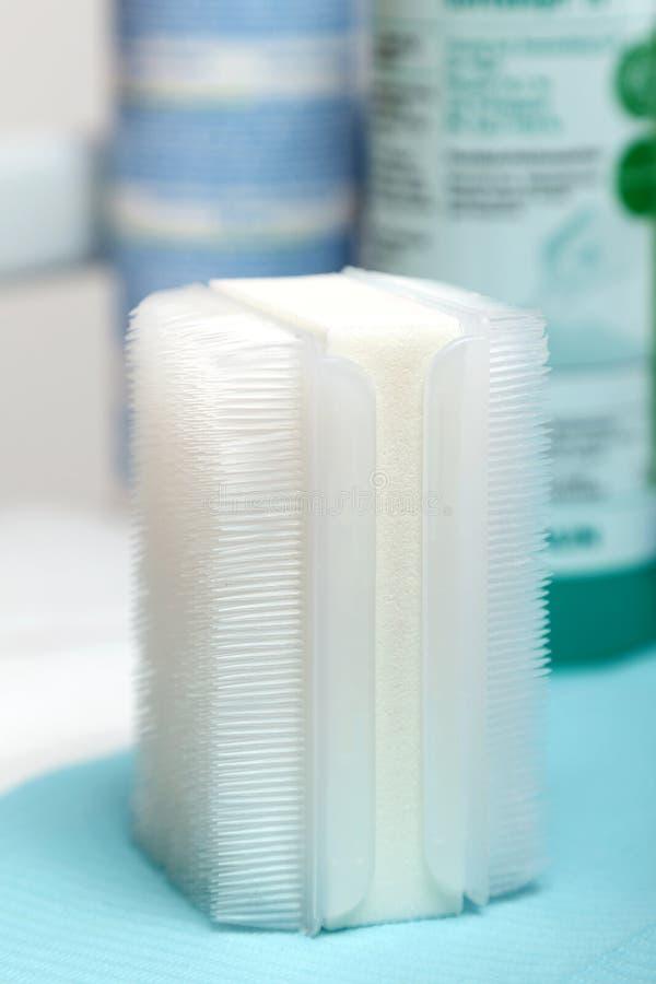 Professional hygienic plastic nailbrush inside podiatrist`s saloon. Close up of professional hygienic plastic nailbrush inside podiatrist`s saloon stock photography