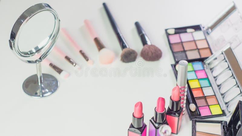 Close up professional makeup cosmetic set, consisting of powder blush, blush, eye shadow, lipstick for beautiful woman makeup, put royalty free stock images