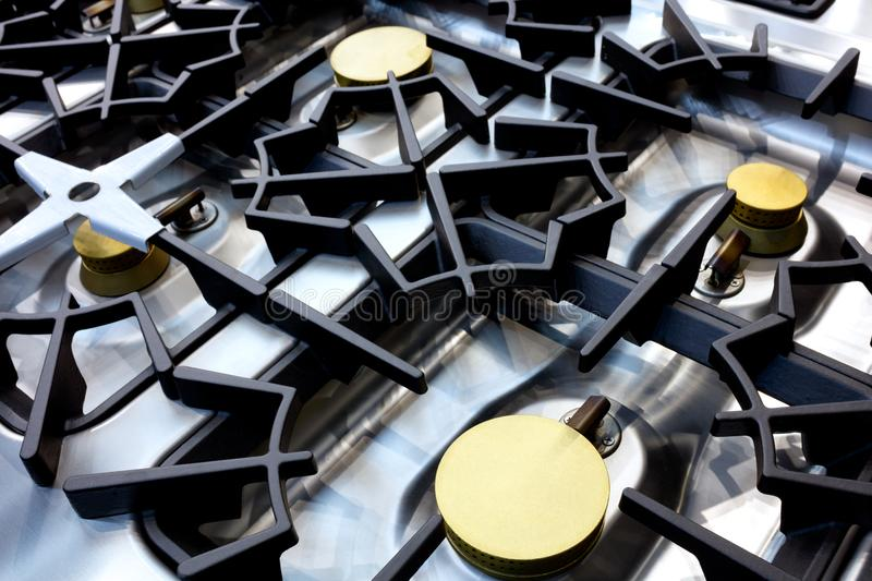 Close up of professional modern shining metal gas cooker in restaurant royalty free stock images