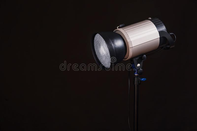Close-up of professional studio light on the black background. C royalty free stock image