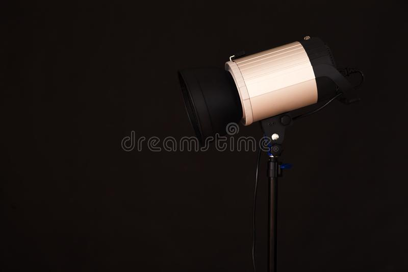 Close-up of professional studio light on the black background. C stock images