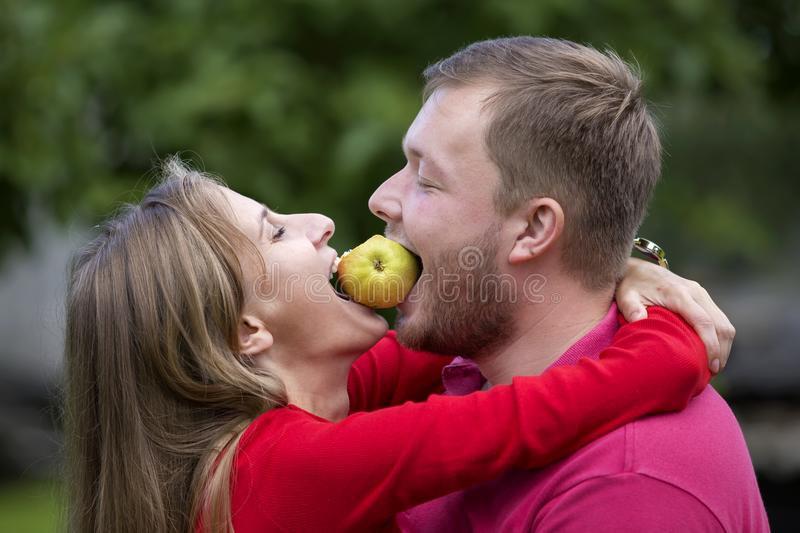 Close-up profile portrait of young attractive happy romantic couple in love having fun, pretty blond long-haired girl and handsome stock photo