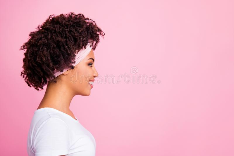 Close-up profile side view portrait of her she nice-looking fascinating charming cute attractive lovely winsome sweet. Cheerful cheery wavy-haired girl isolated royalty free stock images