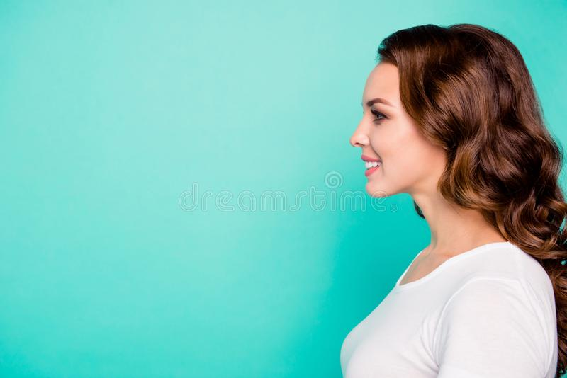 Close-up profile side view portrait of her she nice-looking sweet perfect feminine cheerful cheery wavy-haired girl. Isolated over bright vivid shine blue stock photography