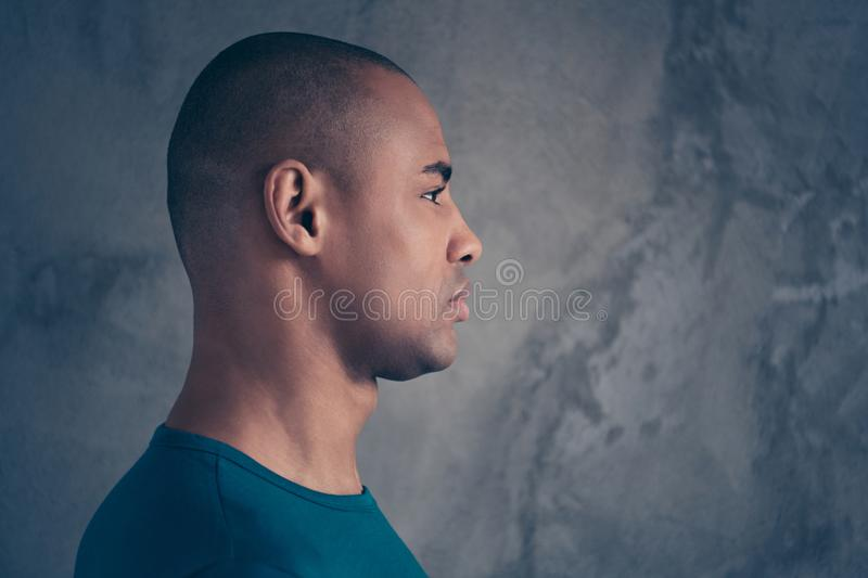 Close-up profile side view portrait of his he nice attractive strong character feature guy wearing casual trendy blue t. Shirt isolated over gray industrial stock photography