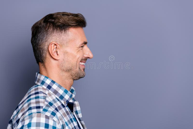 Close-up profile side view portrait of his he nice attractive well-groomed cheerful cheery bearded guy wearing checked royalty free stock images