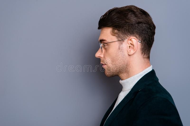 Close-up profile side view portrait of his he nice handsome attractive bearded candid guy wearing velveteen blazer copy. Space thinking isolated over gray stock image