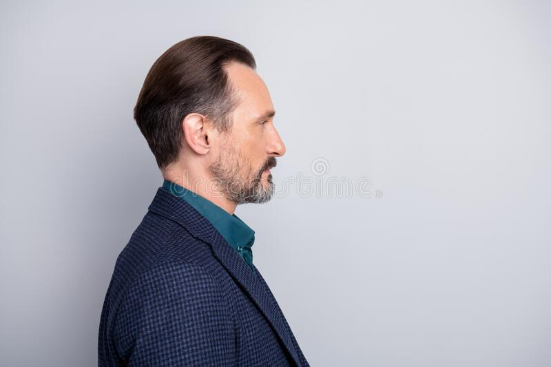 Close-up profile side view portrait of nice attractive content middle age man wearing formal-wear financier economist. Close-up profile side view portrait of stock image