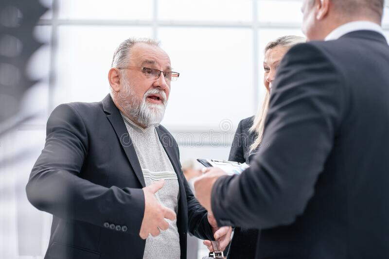 Close up. the project Manager is discussing something with his assistants. royalty free stock image