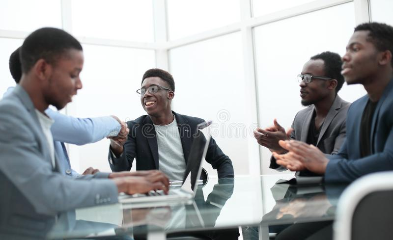 Project Manager explaining something to employees at an office meeting stock photos