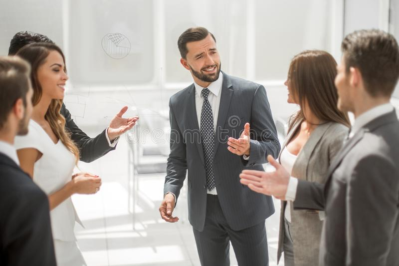 Close up.the project Manager talks to the business team. Photo with copy space royalty free stock photography