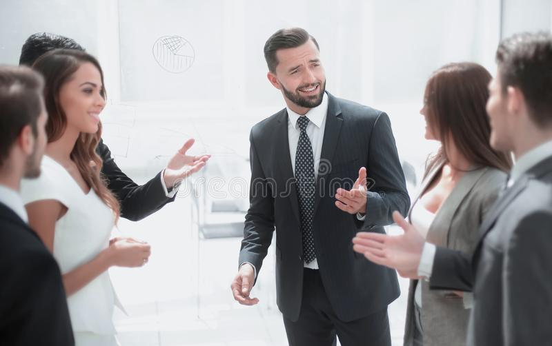 Close up.the project Manager talks to the business team royalty free stock image