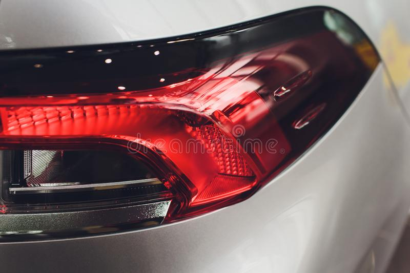 Close up projector Taillight of the modern and elegant car, automotive part concept. royalty free stock images