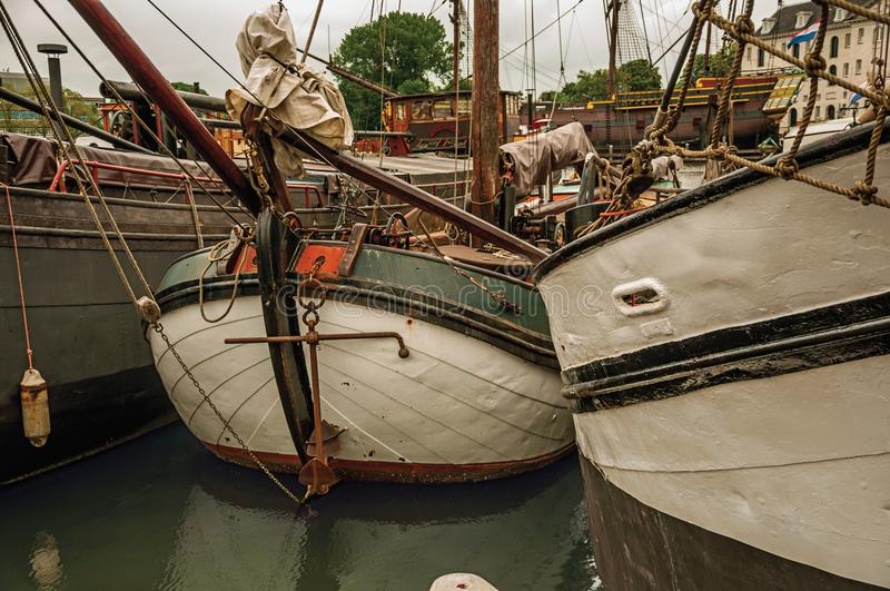 Close-up of prow and rusty anchor of a boat moored in port at Amsterdam. Famous for its huge cultural activity, graceful canals and bridges. Northern royalty free stock images
