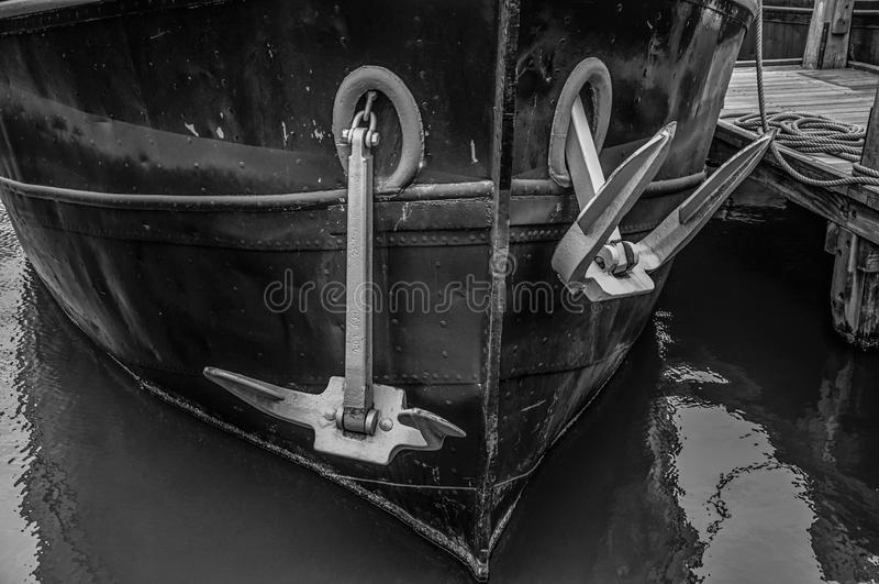 Close-up of prow and rusty anchor of a boat moored in port at Amsterdam. Famous for its huge cultural activity, graceful canals and bridges. Northern royalty free stock photo