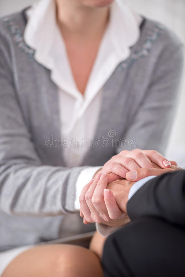Close-up of psychiatrist keeping her hands. Concept of a Close-up of psychiatrist keeping her hands together with her patient royalty free stock photo