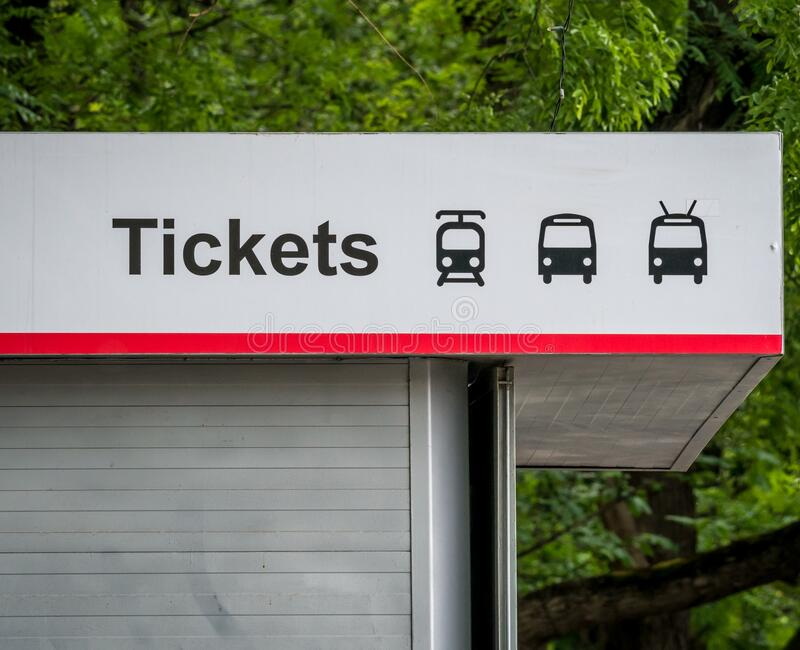 Close up with a public transport tickets booth. Bus, tram and trolleybus symbols on a service booth.  stock photo