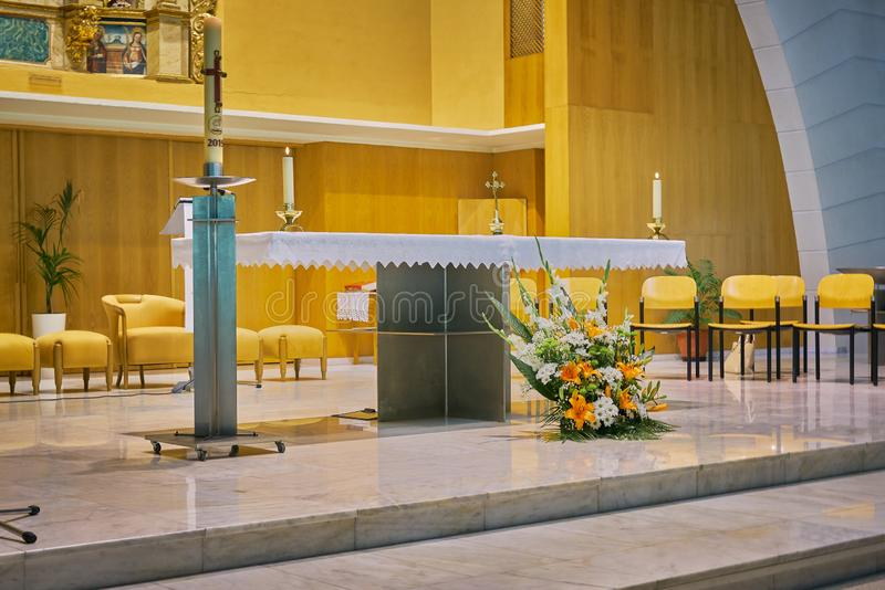 Close-up of the pulpit & x28;ambon& x29; in a modern Catholic church with flower decoration in the foreground. Sunday, religious, pastor, christianity, faith royalty free stock photo