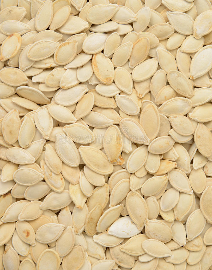 Close-up of pumpkin seeds, food background, isomet royalty free stock photo