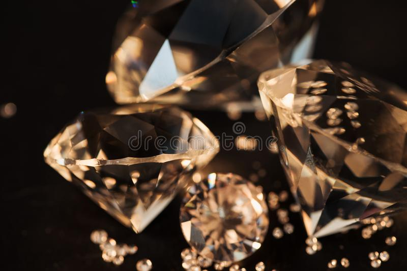 Close up of pure golden diamonds. On black royalty free stock photo