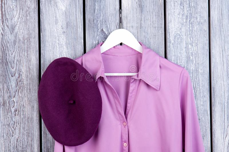 Close up purple shirt and hat, flatlay. stock photos