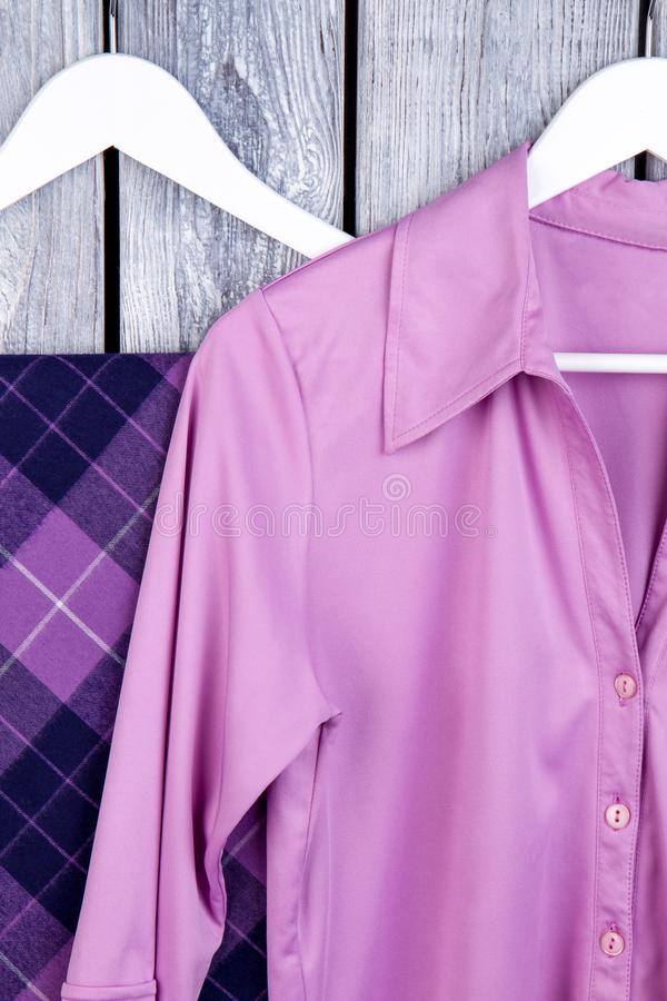 Close up purple silk clothes on hangers. stock photo