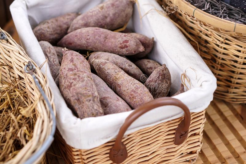 Close up purple sweet potato in a basket royalty free stock photos
