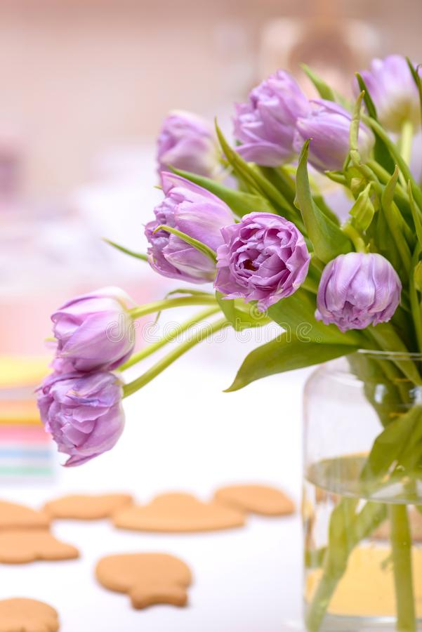 Close-up purple tulips in vase on table royalty free stock image