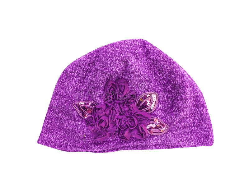 Purple winter hat with flower patterns isolated on white background and clipping path. Close up Purple winter hat with flower patterns isolated on white stock image