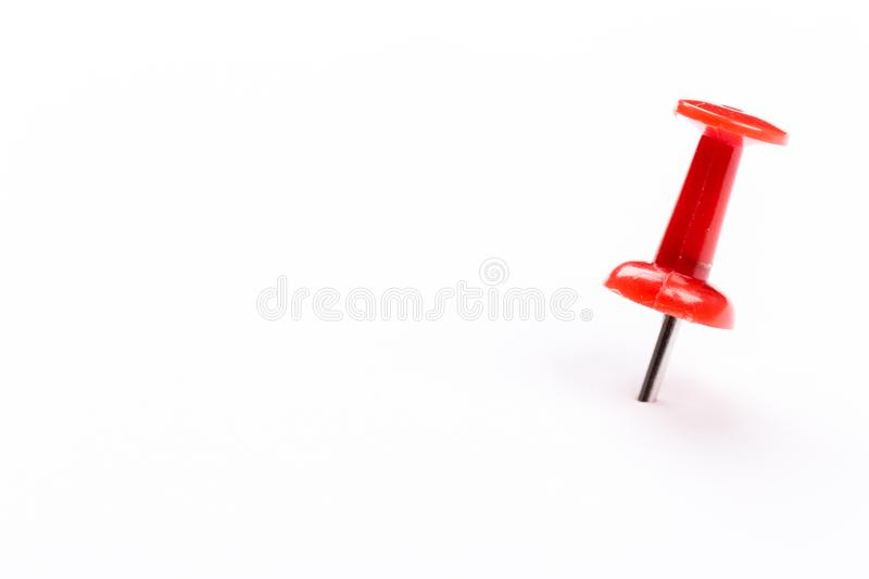 Single red pin isolated on a white background stock photo