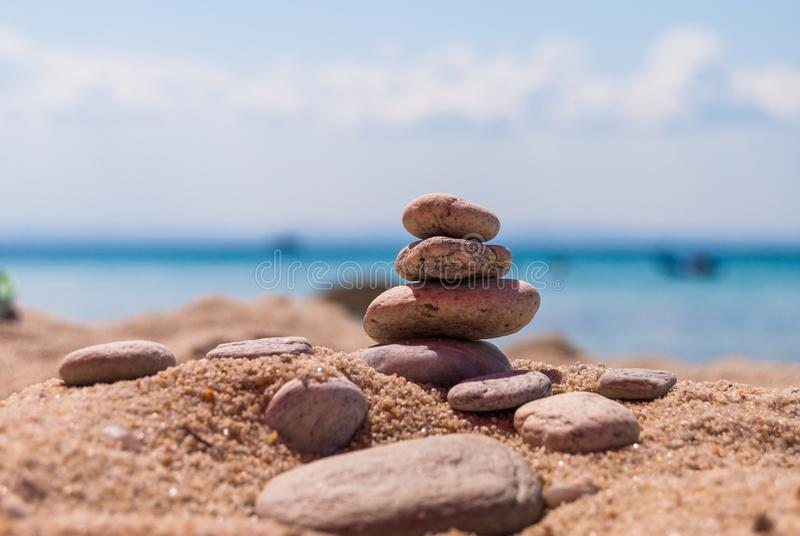 Close-up of a pyramid of stones laid on a sea beach royalty free stock photography