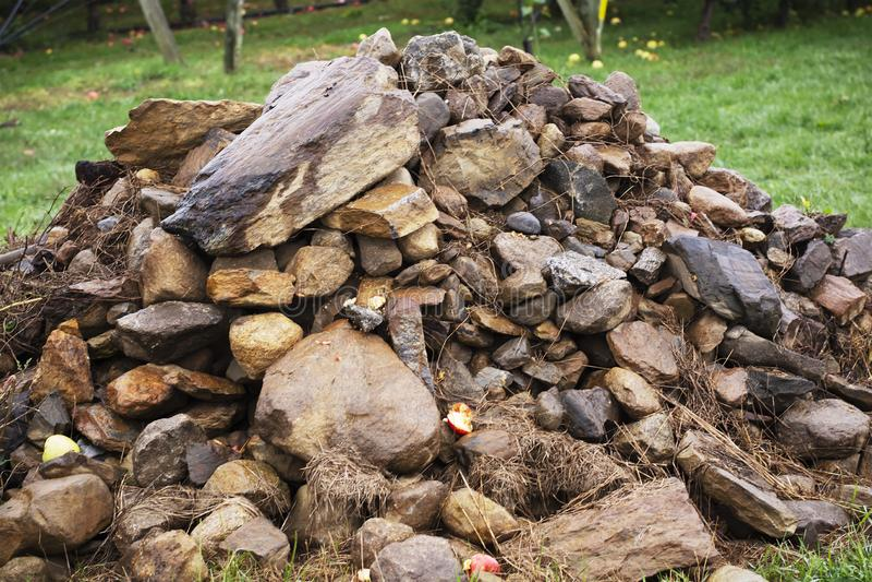 Close up of quarry rock pile on a farm. A close up of quarry rock pile on a farm stock images