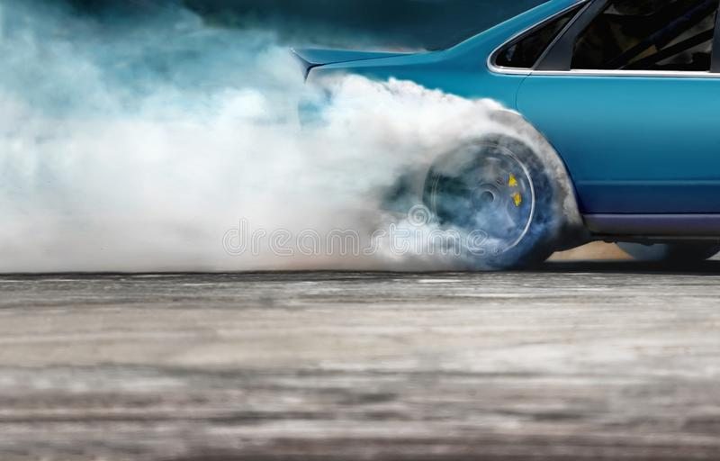 Race drift car burning tires on speed track. Close up Race drift car burning tires on speed track stock photography