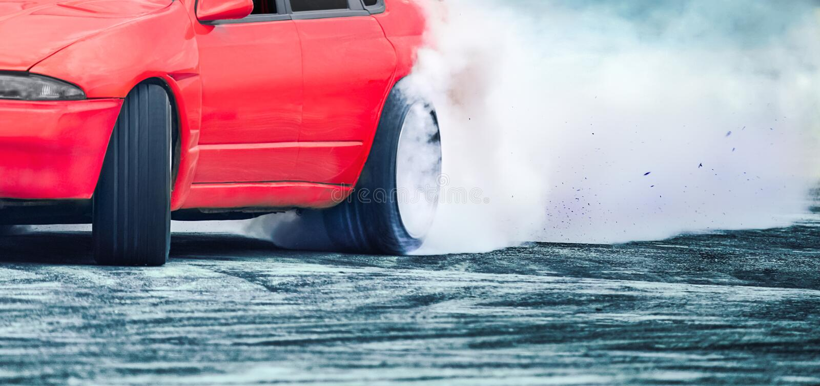 Race drift car burning tires on speed track. Close up Race drift car burning tires on speed track royalty free stock image