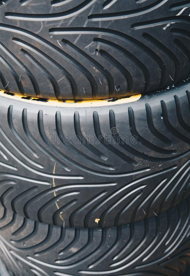 Close up of Racing car tires storage. Storage of tires in a row stock photography