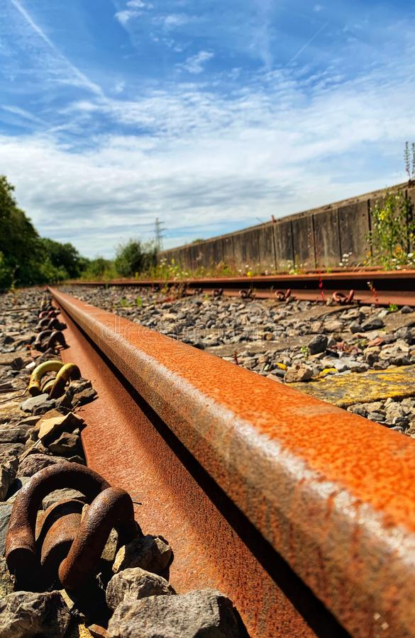 Close up of rail track and fixings. Railway line, ballast and sleepers stock images