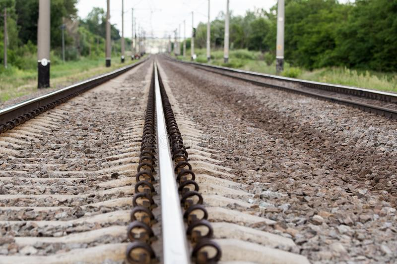 Close-up railroad rails. Cargo trains way. Heavy industry. Industrial background stock photography