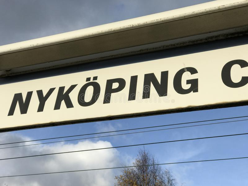Close up of Railroad sign at Nyköping central station, Sweden. Dark letters on white background. Close up of Railroad sign at Nyköping central station royalty free stock image
