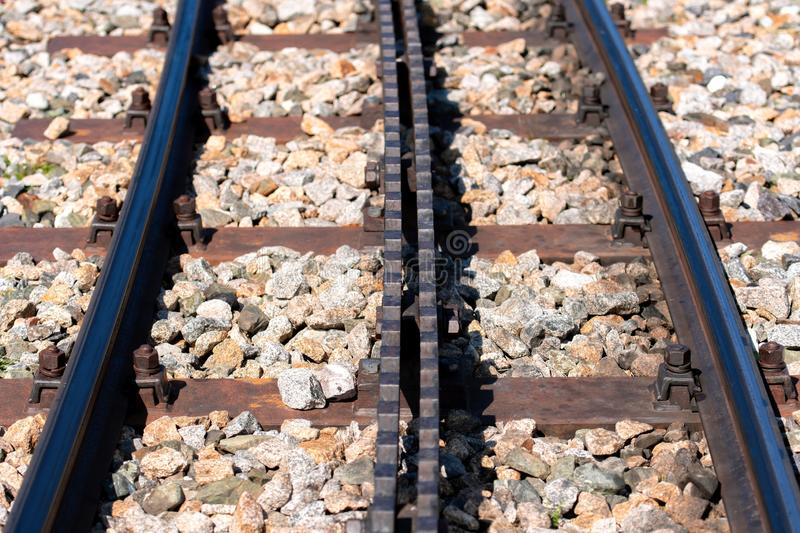 Close-up of a railroad track with a rack.  royalty free stock images