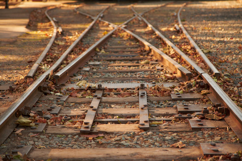 Close up railroad tracks switch. With a fork going to the left and to the right stock photos