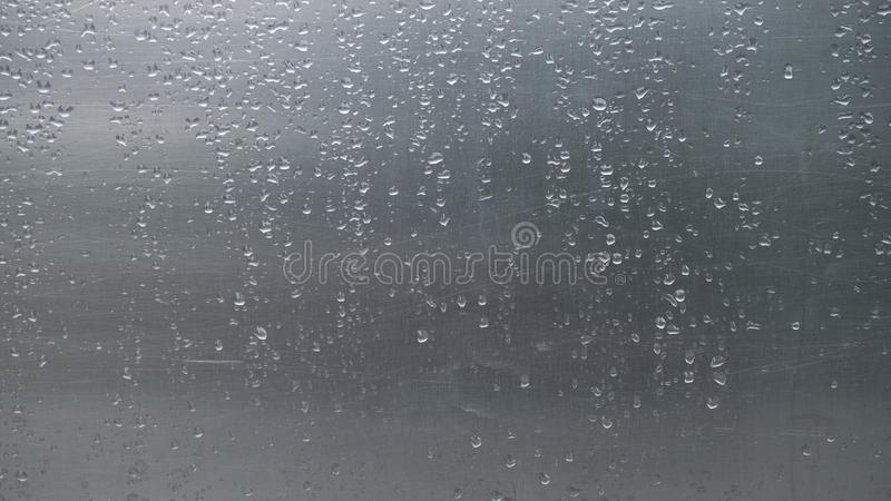 Close up rain drops on scratched aluminium metal sheet. stock images