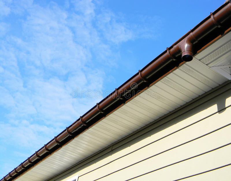 Close up on Rain Gutter Soffit Board, Fascia Board Installation royalty free stock image