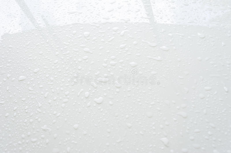 Close up raindrops on windows of car stock image