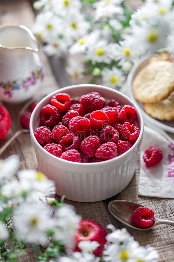 Close-up of Raspberries in Bowl on Table stock photography