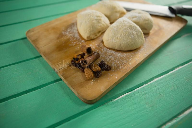 Close up of raw cookies by knife on cutting board stock image